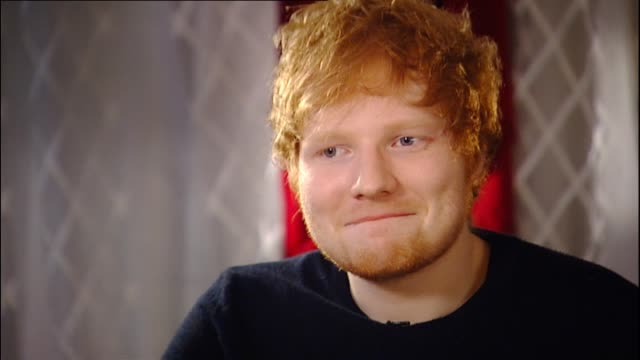 ed sheeran demonstrating his selfie face and speaking in 2014 about the forgiving new zealand crowd during interview with reporter emma keeling - fame stock videos & royalty-free footage