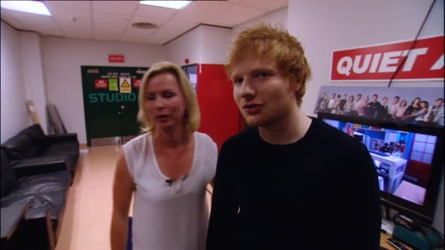 ed sheeran with reporter emma keeling prior to making cameo appearance on new zealand soap television show 'shortland street' in 2014, and speaking... - cameo brooch stock videos & royalty-free footage