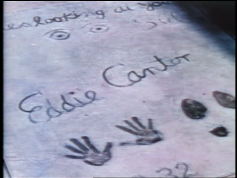 1937 Eddie Cantor's handprints in sidewalk in front of Grauman's Theatre / Hollywood, CA / feature