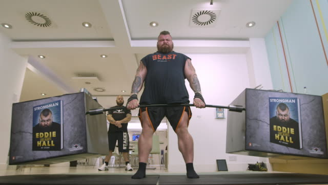 eddie hall attempts recordbreaking dead lift of books at random house on october 18 2017 in london england - strongman stock videos & royalty-free footage