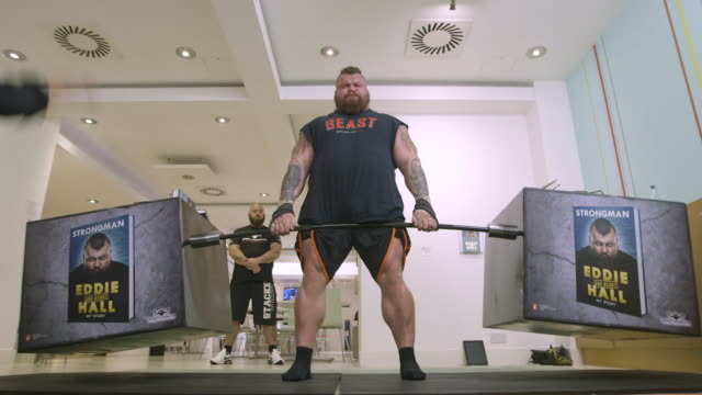 eddie hall attempts recordbreaking dead lift of books at random house on october 18 2017 in london england - world's strongest man stock videos and b-roll footage