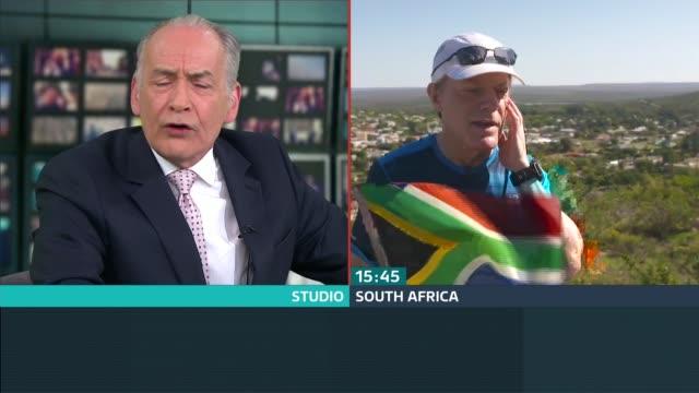 vídeos de stock e filmes b-roll de eddie izzard aims to run 27 marathons in 27 days; england: london: gir: int split box alastair stewart in studio / eddie izzard in south africa eddie... - alastair stewart