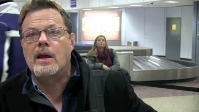 eddie izzard arrives at slc airport in salt lake city 01/19/12 in celebrity sightings in park city, utah - park city stock videos & royalty-free footage