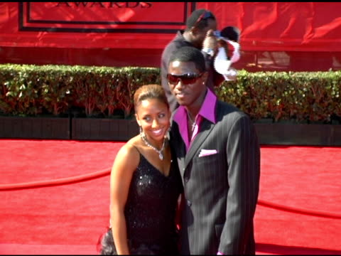Eddie Johnson and guest at the 13th Annual ESPY Awards Arrivals at the Kodak Theatre in Hollywood California on July 13 2005
