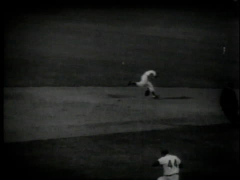 eddie matthews hitting ball and running / hank aaron hitting the ball and putting two runners on the bases - philadelphia phillies stock videos and b-roll footage