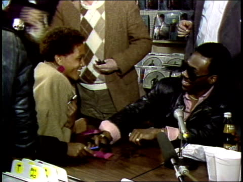 eddie murphy getting kissed by fans at signing in washington dc - anno 1983 video stock e b–roll