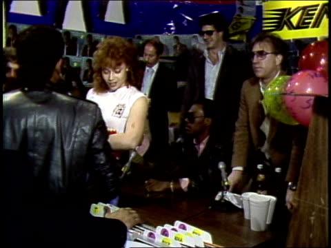 eddie murphy signing a girl's tshirt at record store in washington dc - eddie murphy stock videos & royalty-free footage