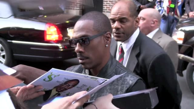 eddie murphy signs autographs for fans as he departs the 'late show with david letterman' in new york 10/25/11 - autographing stock videos & royalty-free footage