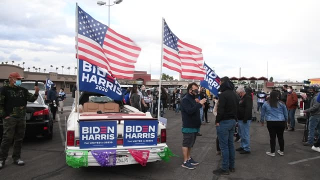 eddie ramos' 1991 lincoln town car is decked out in biden-harris flags and signs as supporters of joe biden prepare to hold a car parade to celebrate... - lincoln town car stock videos & royalty-free footage