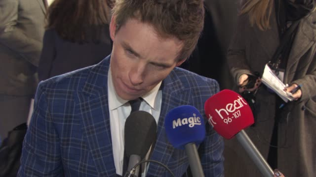 eddie redmayne at 'the theory of everything' uk film premiere at odeon leicester square on december 08 2014 in london england - audio electronics stock videos & royalty-free footage