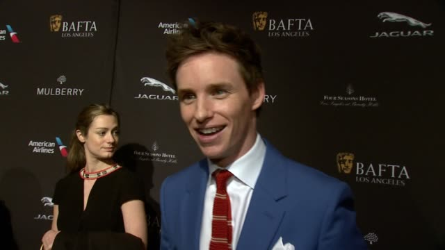interview eddie redmayne on his amazing year on being at the event on what makes the bafta tea party one of the most prestigious events of the... - golden globe awards stock videos and b-roll footage