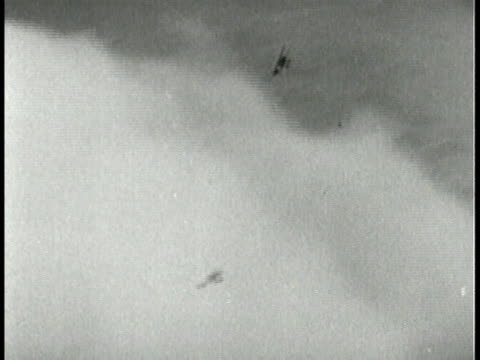 Eddie Rickenbacker flying in airplane shooting down enemy planes