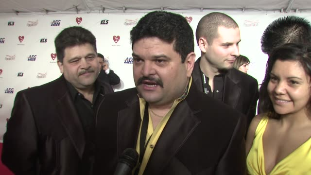 Eddie Rodriguez and 'Los Volcanos' on being chosen by Neil Diamond to perform one of his songs at the MusiCaresr 2009 Person Of The Year Tribute at...