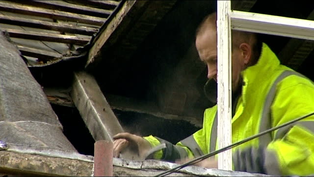 eddie 'the eagle' edwards prepares for new jump england gloucestershire ext eddie 'the eagle' edwards working on roof window edwards working on... - dacherker stock-videos und b-roll-filmmaterial