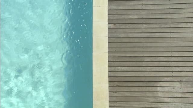 OH MS Edge of wooden deck and swimming pool/ Cape Town, South Africa