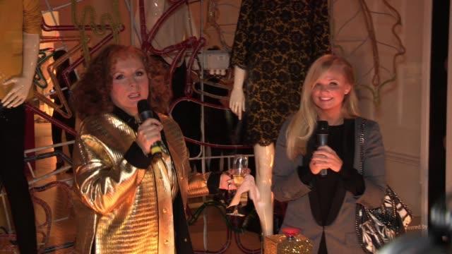 Edina Monsoon aka Jennifer Saunder and Emma Bunton singing and putting on the lights at the Stella McCartney Bruton Street Store Christmas Light...
