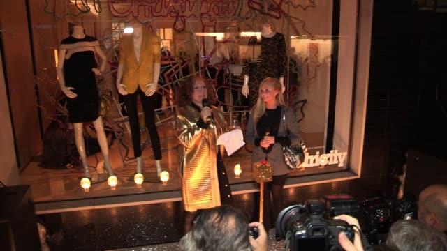 Edina Monsoon aka Jennifer Saunders introducing Emma Bunton at the Stella McCartney Bruton Street Store Christmas Light Switchon at London England