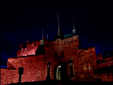 edinburgh castle illuminated by red light at night scotland - castle stock videos & royalty-free footage