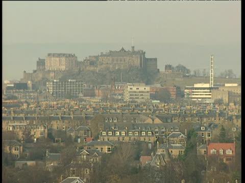 edinburgh castle in distance on hazy day - edinburgh castle stock videos & royalty-free footage