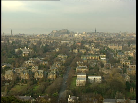 edinburgh castle in distance pan right over city to mountains - edinburgh castle stock videos & royalty-free footage