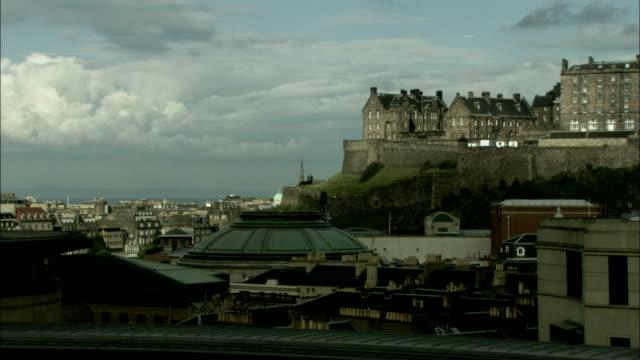 edinburgh castle overlooks the city. available in hd. - edinburgh castle stock videos & royalty-free footage