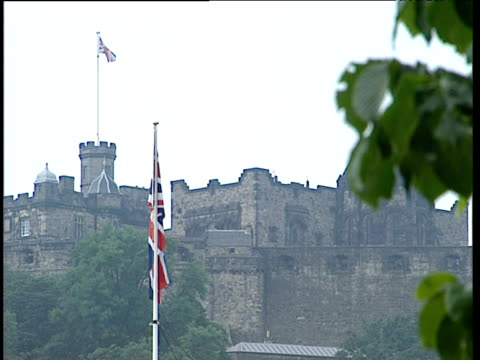 edinburgh castle with two union jack flags blowing in wind - edinburgh castle stock videos & royalty-free footage