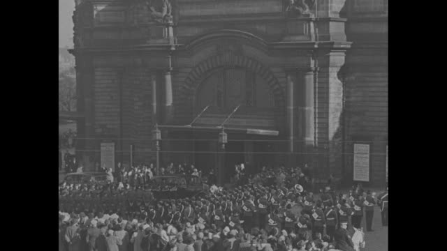 wv edinburgh / crowd is gathered in front of usher hall / after princess elizabeth and prince philip get out of car woman gives elizabeth bouquet of... - 1949 stock videos and b-roll footage