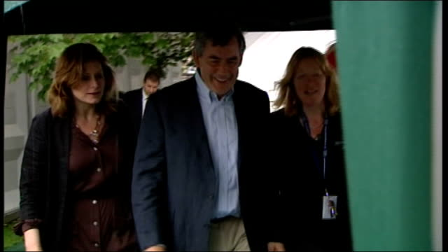 Edinburgh Gordon Brown dressed casually in chinos and shirt without tie and wife Sarah Brown wearing brown shirtwaister dress and black cardigan...