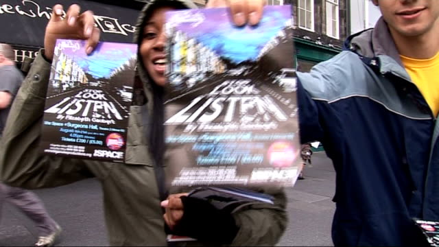 edinburgh fringe festival focuses on verbatim plays man wearing black face mask handing out theatre flyers to passersby various of people handing out... - toga stock videos and b-roll footage