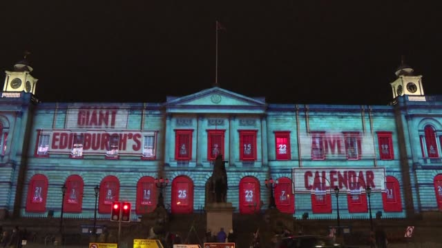 edinburgh gets ready for christmas by opening the first door in its giant advent calendar projection - advent stock videos & royalty-free footage