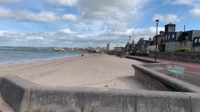 edinburgh's portobello beach remains quiet as scotland continues to observe social distancing measures across the bank holiday weekend. - portobello mushroom stock videos & royalty-free footage