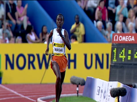 Edith Masai checks her time on wrist watch as she wins Women's 5000m 2004 Crystal Palace Athletics Grand Prix London