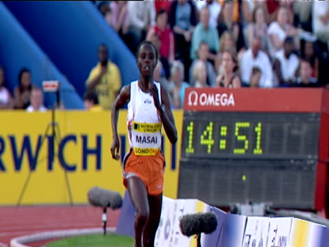 edith masai wins women's 5000m checks her time on stopwatch 2004 crystal palace athletics grand prix london - dynamics stock videos and b-roll footage