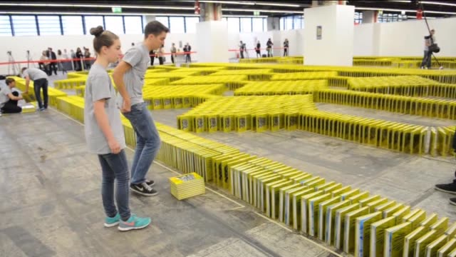 editions of the guinness book of world records fall during a world record attempt at book dominos during the 2015 frankfurt book fair in frankfurt am... - dominoes stock videos & royalty-free footage