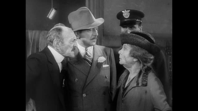1931 editor (adolph menjou) flatly denies allegations of kidnapping after being accused by elderly woman in front of police - 1931 stock videos & royalty-free footage