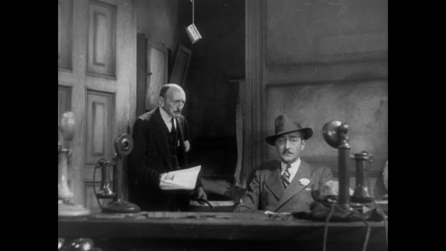 1931 editor (adolph menjou) hands irritated sheriff a magazine as he walks into the bathroom - 1931 stock videos & royalty-free footage