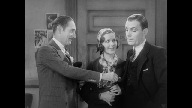 1931 editor (adolph menjou) says goodbye to reporter (pat o'brien) and his fiance (mary brian) - 1931 stock videos & royalty-free footage