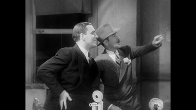 1931 editor (adolph menjou) tells reporter (pat o'brien) that they'll name a street after him - 1931 stock videos & royalty-free footage