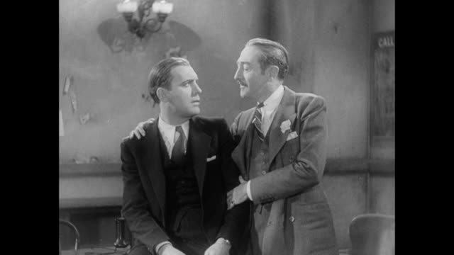1931 editor (adolph menjou) tries to comfort heartbroken reporter (pat o'brien) but only makes things worse - relationship breakup stock videos & royalty-free footage