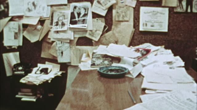 ms, pan, editorial cartoonist at work, 1970's, los angeles, california, usa - cartoonist stock videos & royalty-free footage