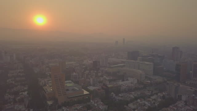 mexico city very unhealthy air quality day this is the stuff of editorial i shot these images today from a drone these are aerial shots from polanco... - editorial stock videos & royalty-free footage