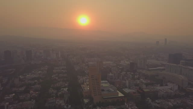 mexico city - very unhealthy air quality day this is the stuff of editorial, i shot these images today from a drone, these are aerial shots from... - editorial bildbanksvideor och videomaterial från bakom kulisserna