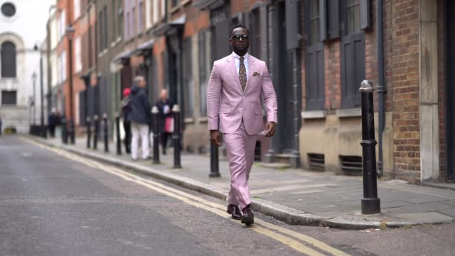 edmond kamara wears a pink blazer jacket a white shirt a tie pink pants brown leather shoes sunglasses during london fashion week men's june 2019 on... - leather jacket stock videos and b-roll footage
