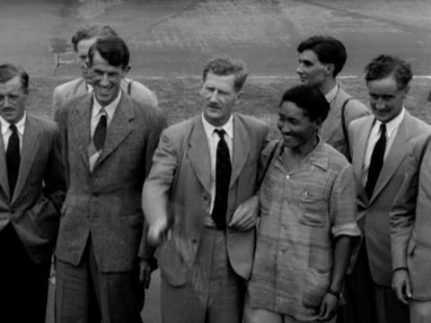 edmund hillary, john hunt, tenzing norgay and the rest of the successful everest expedition party pose for photographers on their arrival back at... - tenzing norgay stock videos & royalty-free footage