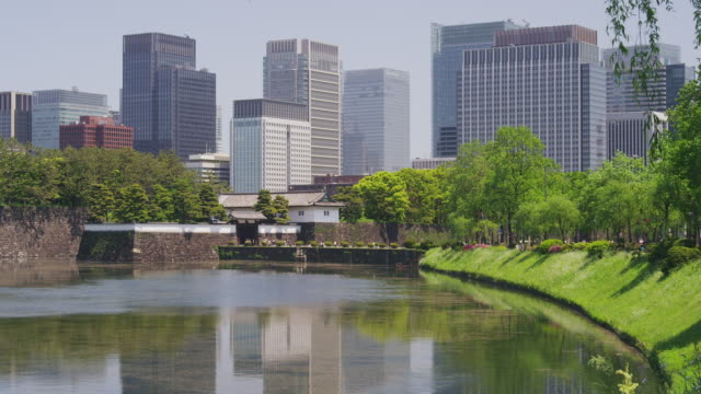 edo castle and office buildings at marunouchi, tokyo, japan - moat stock videos and b-roll footage