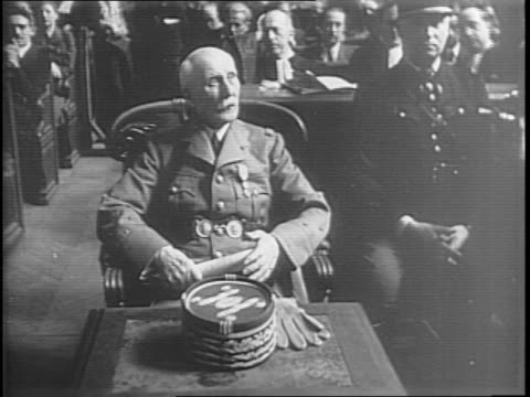 Edouard Daladier being sworn in / view of the courtroom / Maitre Isorni speaking to the courtroom / judges listening / Marshal Philippe Petain...