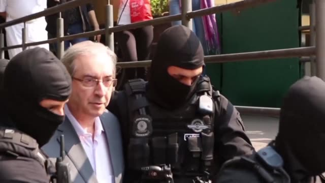 Eduardo Cunha the driving force behind former president Dilma Rousseff's impeachment is escorted under close guard to the Institute of Criminology of...