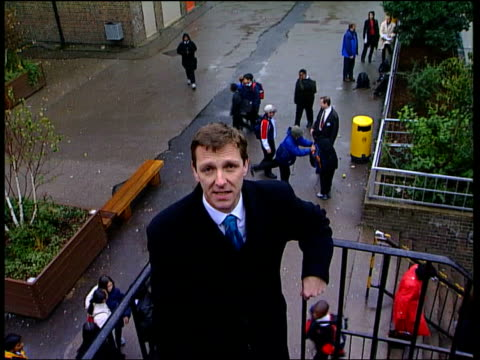 Blair Call for Culture Change ITN ENGLAND London Islington Islington Arts and Media School Boy arriving at school and passing security guards at gate...
