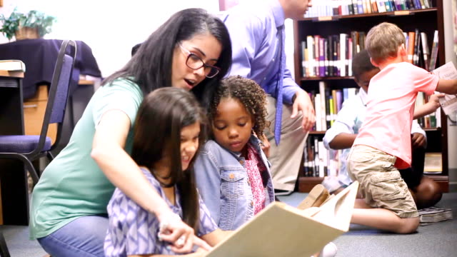 education. brarian reads book to elementary students in library or classroom. - librarian stock videos & royalty-free footage