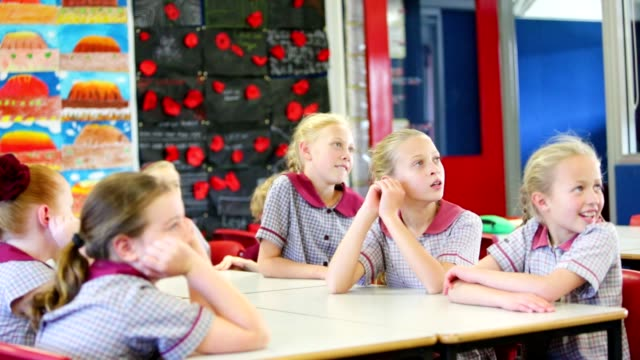 education children answering a question in class - uniform stock videos & royalty-free footage